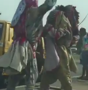 Hilarious! Two Masquerades Exchange Blows In Lagos (photos)