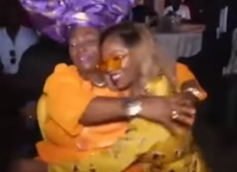 Video: Tiwa Savage kneels to greet Madam Kofo in Lagos