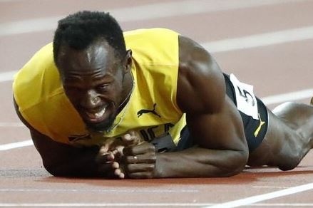 Usain Bolt suffers injury during final race of his career and break down in tears