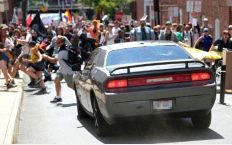 One dead and 19 injured as speeding car rams into protesters in Charlottesville