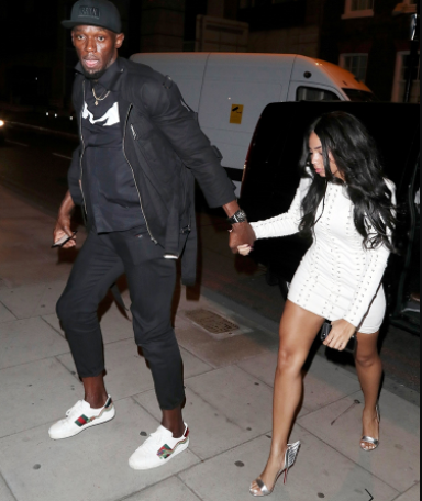 Usain Bolt seen with mystery stain on his pants while leaving a club with his girlfriend