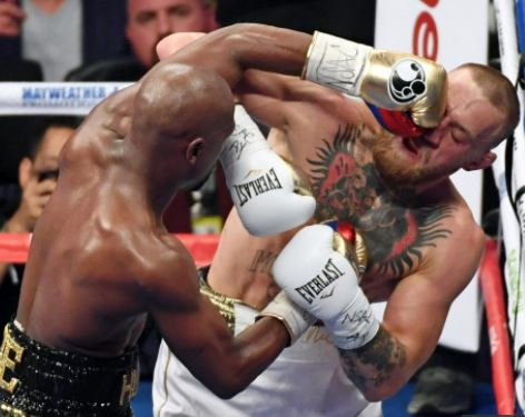 Doctor says Conor McGregor suffered mild traumatic brain injury during TKO loss to Floyd Mayweather