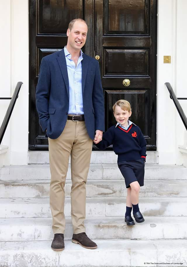prince George with dad Prince William taking a photo before first day at school.