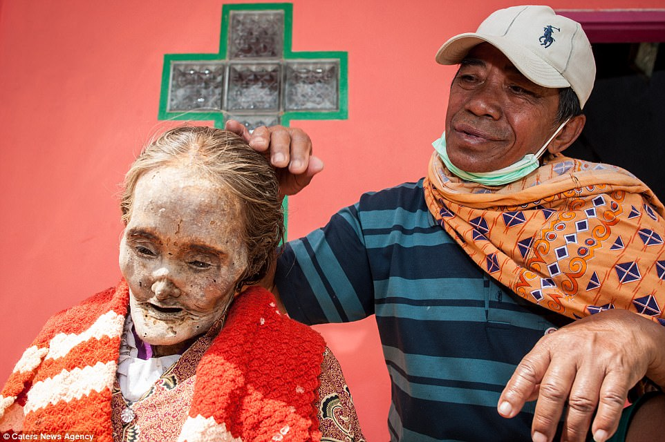 Photos from Indonesia's annual harvest ritual where corpses are exhumed and groomed before being paraded