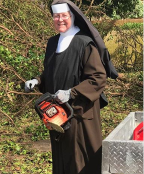 Chainsaw-wielding catholic nun in her full habit cleans up Hurricane Irma damage