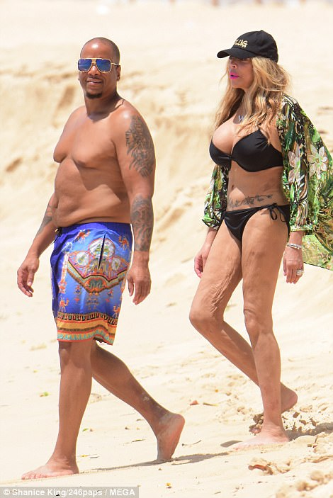 More unsightly photos of Wendy Williams as she falls over in her skimpy bikini