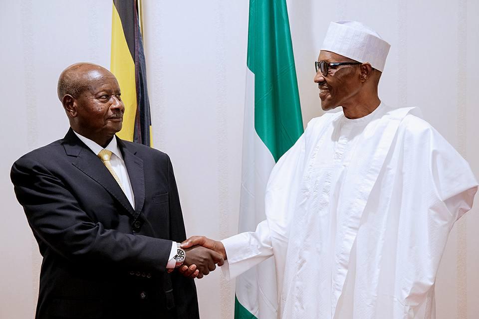 Photos: President Buhari receives Ugandan president and