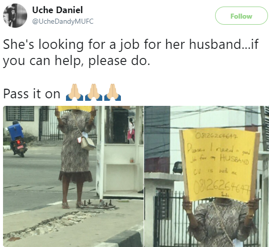 Wife holds placard on the street as she appeals to Nigerians to help her husband with a good job