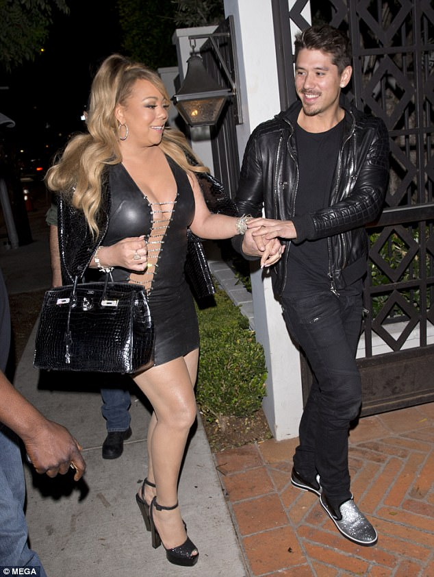 Mariah Carey gets a helping hand from beau Bryan Tanaka as she steps out in skimpy dress (Photos)