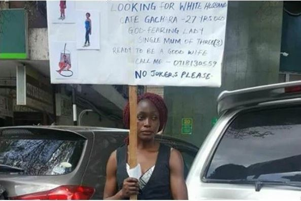 Desperate single mother of three takes to the street to look for white husband (photos)
