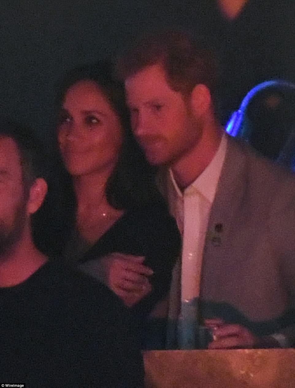 Prince Harry and gf Meghan Markle display some PDA at the closing of Invictus ceremony
