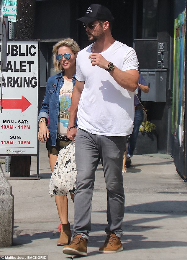 Photos: Actress Elsa Pataky shows off her toned legs as she enjoys a stroll with husband Chris Hemsworth in LA
