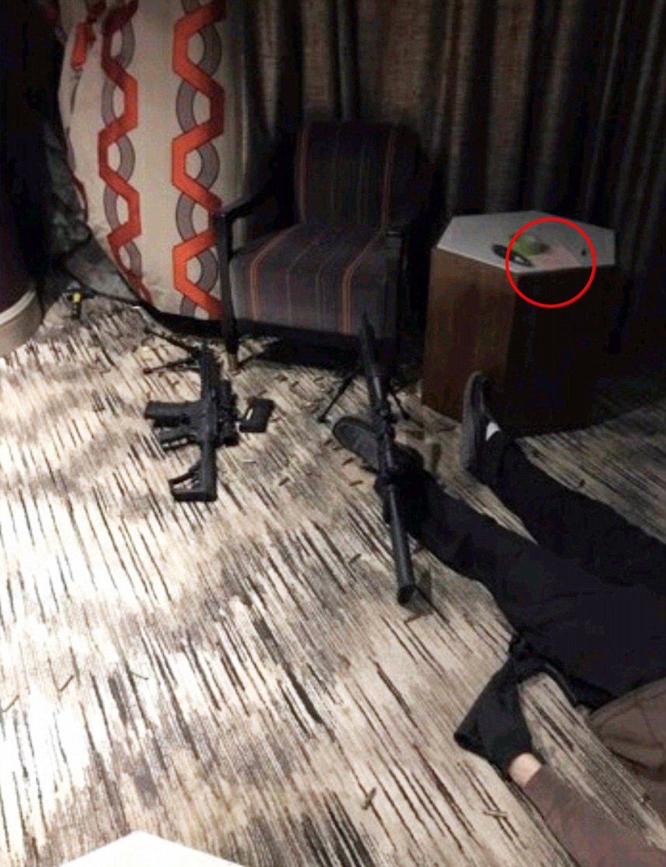 Leaked photos of dead Vegas gunman and his weapons surfaces