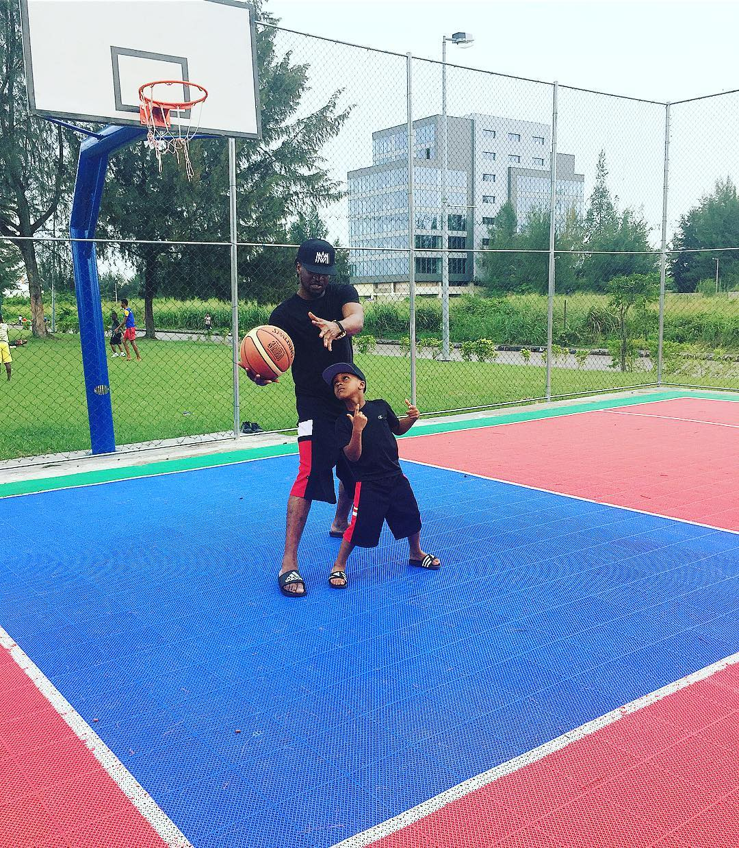 Paul Okoye and his son, Andre hang out on a basketball court (photos)