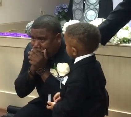 Groom stares in shock then breaks down in tears as he beholds his bride walking down the aisle (video)