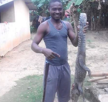 Man shares photo of a crocodile he killed in Niger Delta