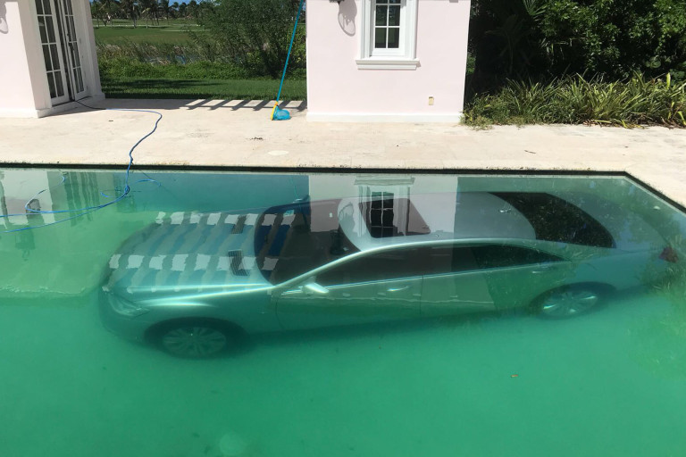 Jilted girlfriend of a handsome banker drives his $100k Benz into pool for ending their relationship (Photos)