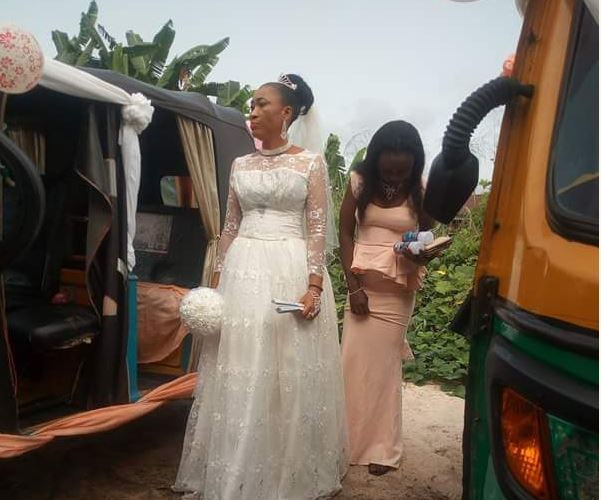 Viral photos of Nigerian couple arriving their wedding reception in tricycles