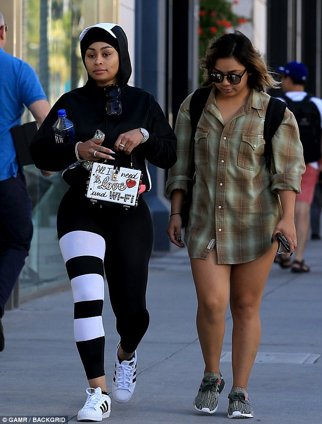 Blac Chyna steps out in sports see-through leggings and $3K D&G purse after suing all the Kardashians for sabotaging her reality show with Rob (Photos)