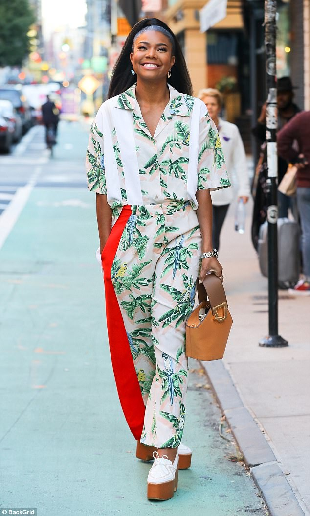 Gabrielle Union steps out looking gorgeous in bold tropical two-piece after admitting she was raped at gunpoint