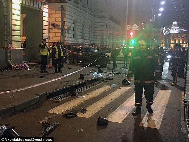 Carnage as Ukrainian heiress, 20, jumps a red light and kills six people when her car smashes into pedestrians, forcing her armed guards to protect her from angry crowds
