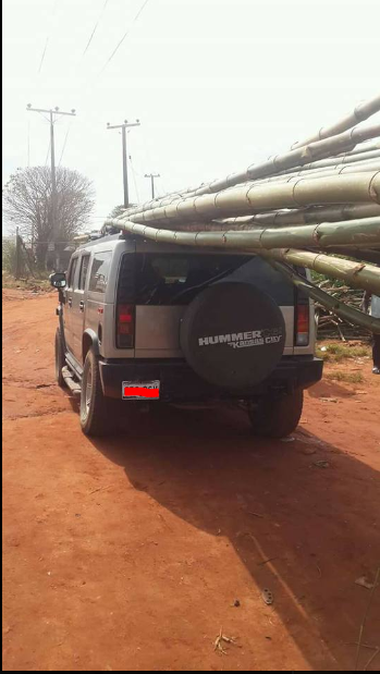 Viral photos of a Hummer SUV being used to transport bamboo sticks from the market in Anambra