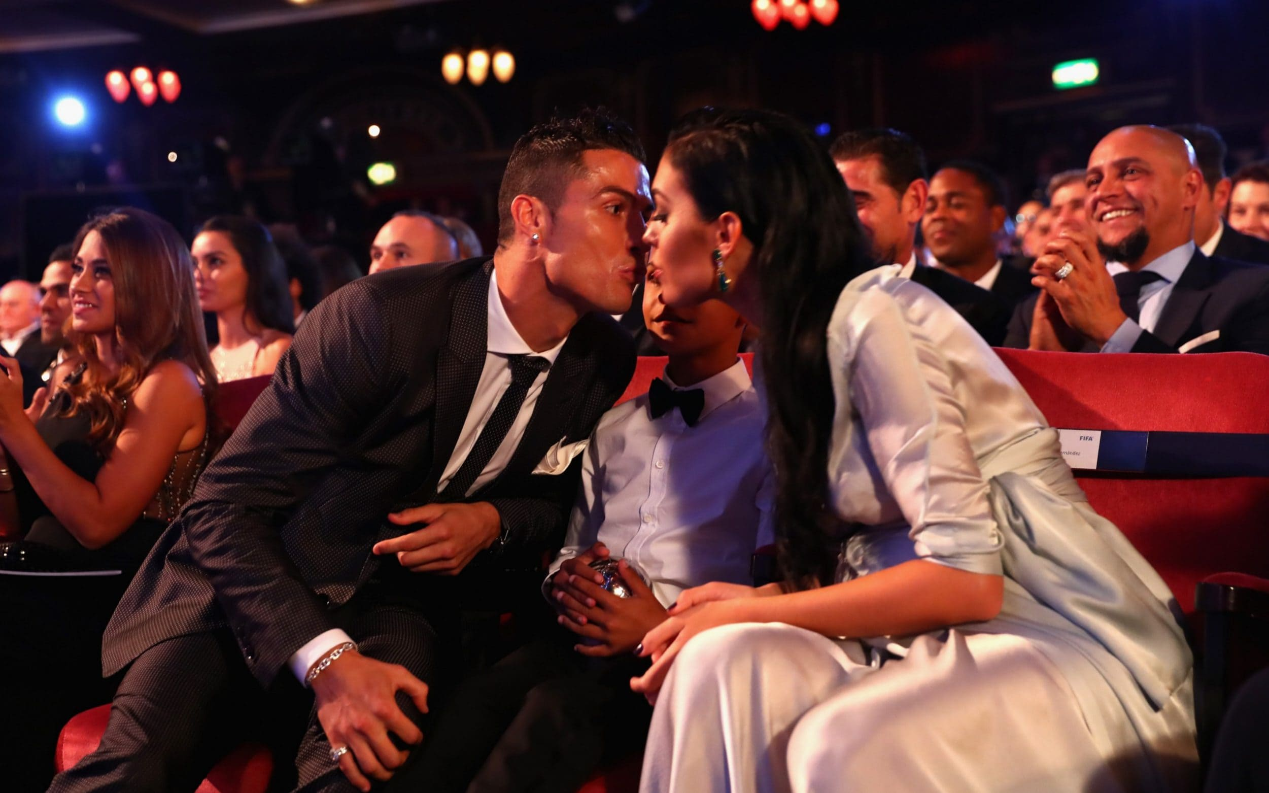 Cristiano Ronaldo kisses his son Cristiano Jnr and pregnant girlfriend Georgina Rodriguez before going up on stage to pick up his World best player award  (Video)