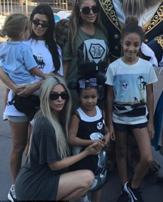 Kim Kardashian heads to Disneyland for fun-filled outing with Kourtney and their kids