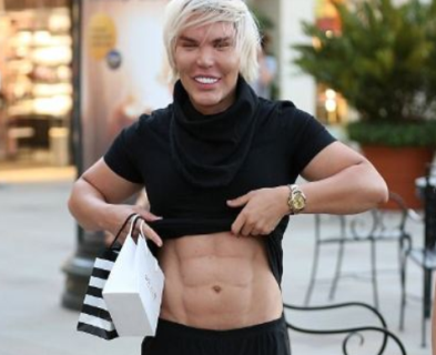 Human Ken Doll shows off his $29,000 surgically enhanced six-packs