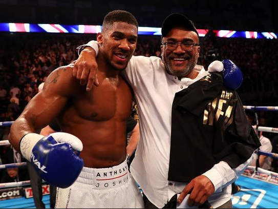 Photo:?Anthony Joshua strikes a pose with his Nigerian dad after the win over?Carlos Takam
