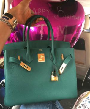 Toke Makinwa flaunts new Hermes Birkin bag she got for her 33rd birthday today....(photos)