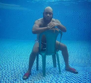 Whose uncle is this inside swimming pool?