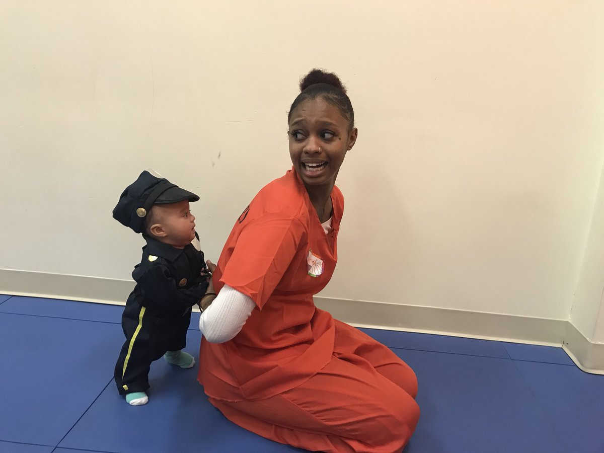 Check out these cute photos of a mother getting arrested by her baby son dressed as police officer on his first Halloween