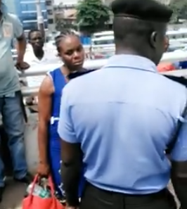 Photo/Video: Police officers, Bus drivers and conductors stop young lady from committing suicide along CMS bridge, Lagos