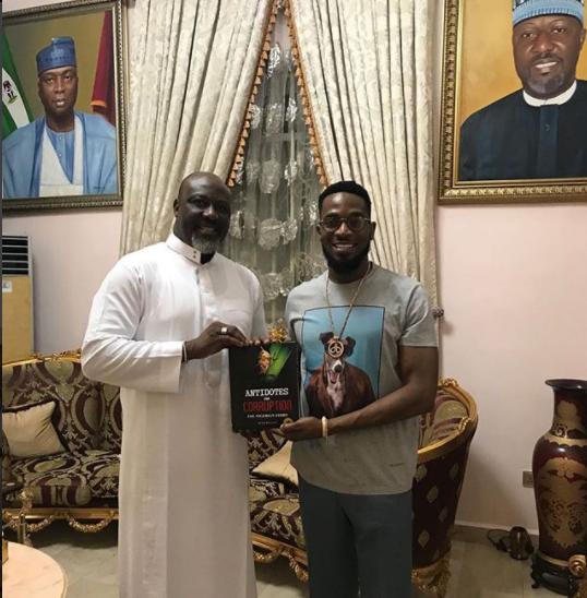 Photo: Dino Melaye presents his new book on corruption to Dbanj in Abuja