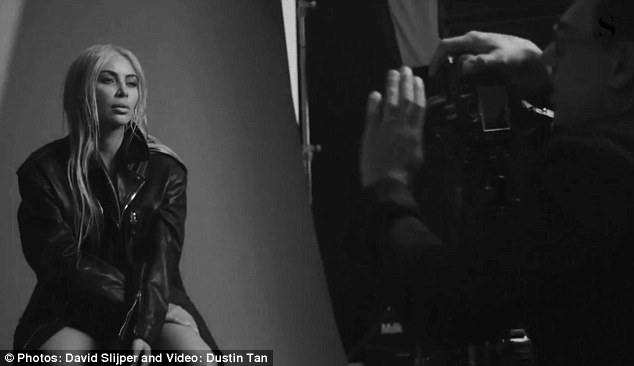 Kim Kardashian puts her cleavage on display in slinky black dress on the cover of S Moda Magazine