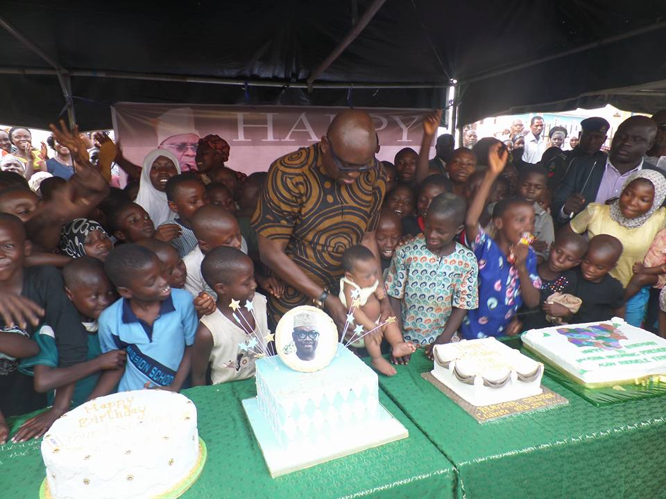 Photos: Governor Fayose treats little children to pieces of cake at his 57th birthday street party