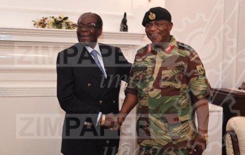Photo: Robert Mugabe meets & shakes hand with Army chief amidst reports of