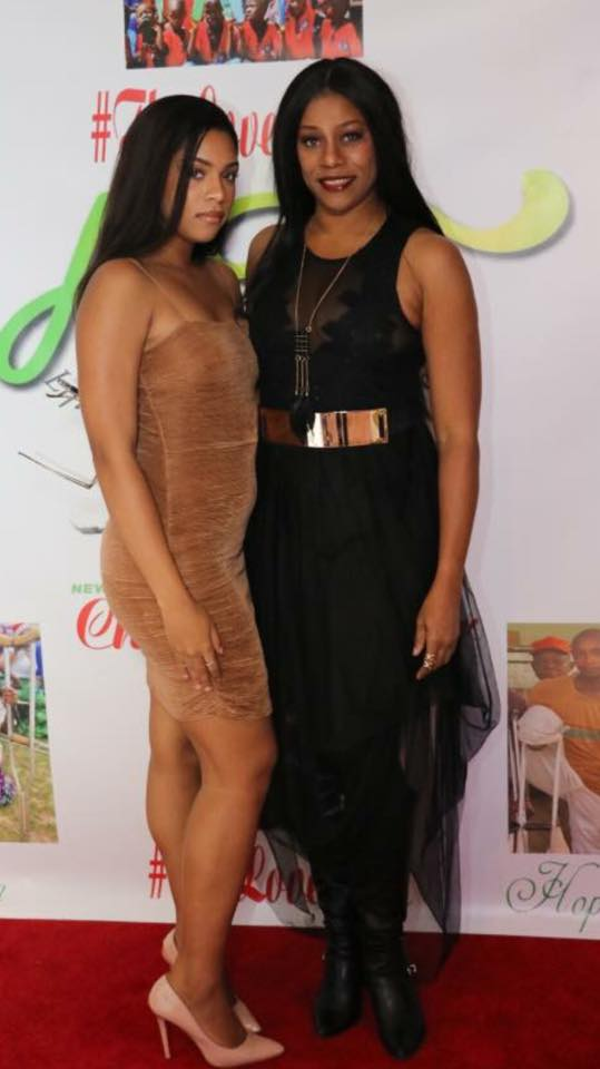 Wow! Regina Askia and her daughter could pass for sisters in this photo