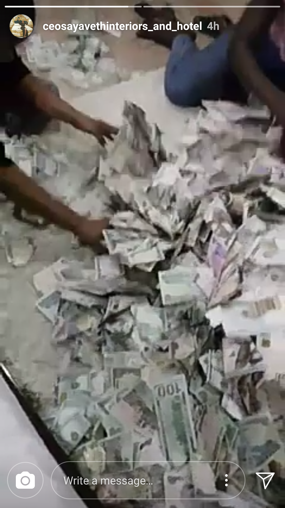 Interior designer Ehi Ogbebor shares a look at bundles of 100 dollar bills & 1000 naira notes she was sprayed at her wedding (photos/video)