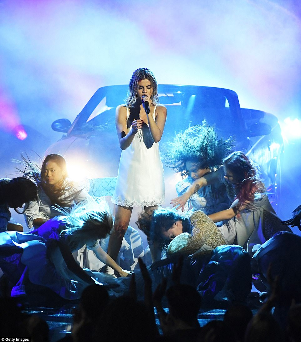 Selena Gomez flashes her underwear in white nightgown as she hits stage for the first time since kidney transplant
