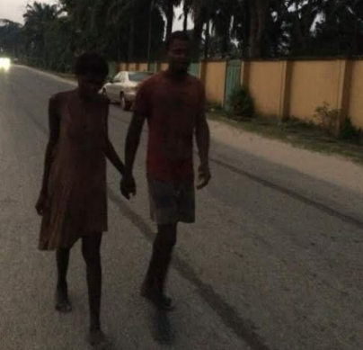 Photo: Mentally unstable couple hold hands as they take romantic stroll in Sapele