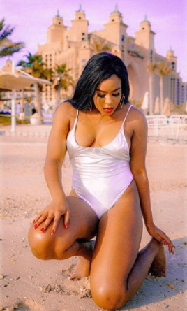 Emma Nyra flaunts side boob in swimsuit as she vacations in Dubai (photos)