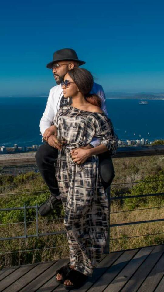 BTS photos of BankyW and Adesua Etomi kissing on set of a photoshoot in Cape Town today (photos)