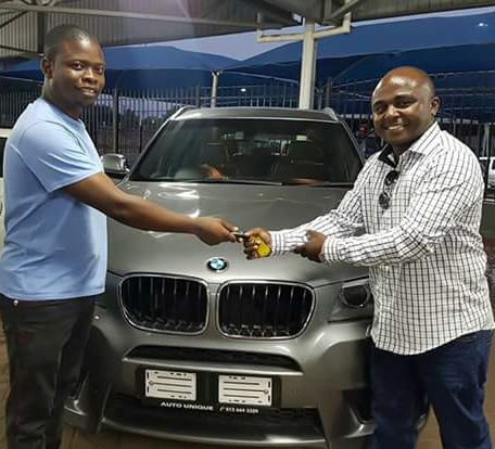 Photos: Wealthy Malawi pastor, Prophet Shepherd Bushiri surprises two members of his media team with brand new BMW X3