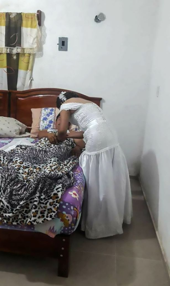 Nurse leaves her own wedding to attend to patient while still wearing her wedding  gown