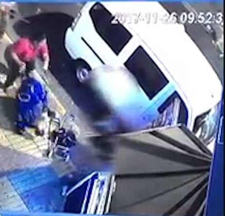 Terrifying moment woman picks pushchair with 8-month-old baby inside and throws it to the street during deadly knife fight that saw her and her husband killed