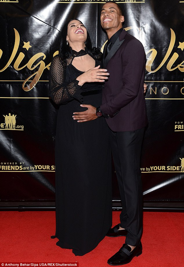 Proud mother-to-be Jordin Sparks cradles her growing bump as she poses with husband Dana Isaiah (Photos)
