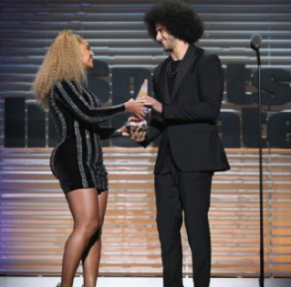 Beyonce makes a surprise appearance at Sports Illustrated Person of the Year event to present Colin Kaepernick with award (video)
