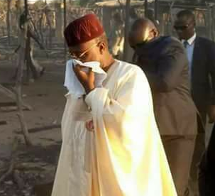 Photo: Adamawa state governor forced to cover his nose following stench from corpses of victims of the clash between herdsmen and farmer in Dong